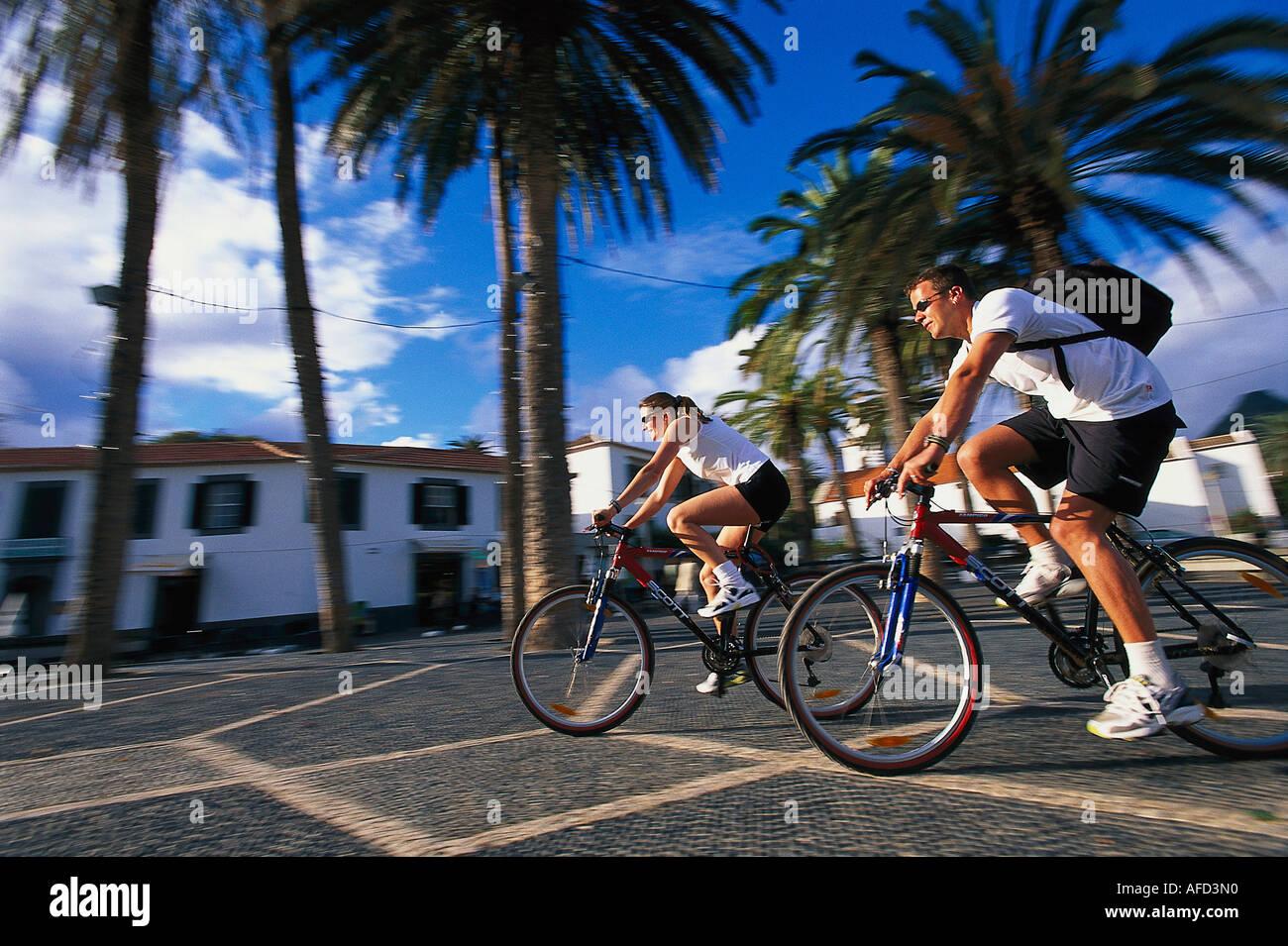 Two Mountain bikers in Villa Baleira, Porto Santo, Madeira, Portugal - Stock Image