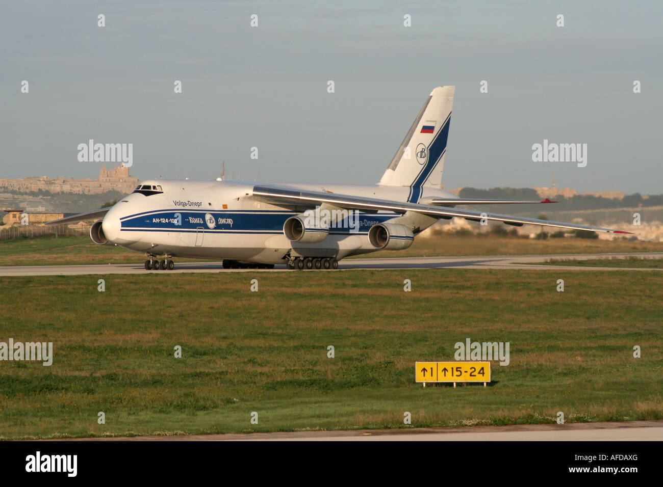 Air freight transport. Antonov An-124 Ruslan heavy cargo jet operated by Volga-Dnepr Airlines taxiing for departure Stock Photo