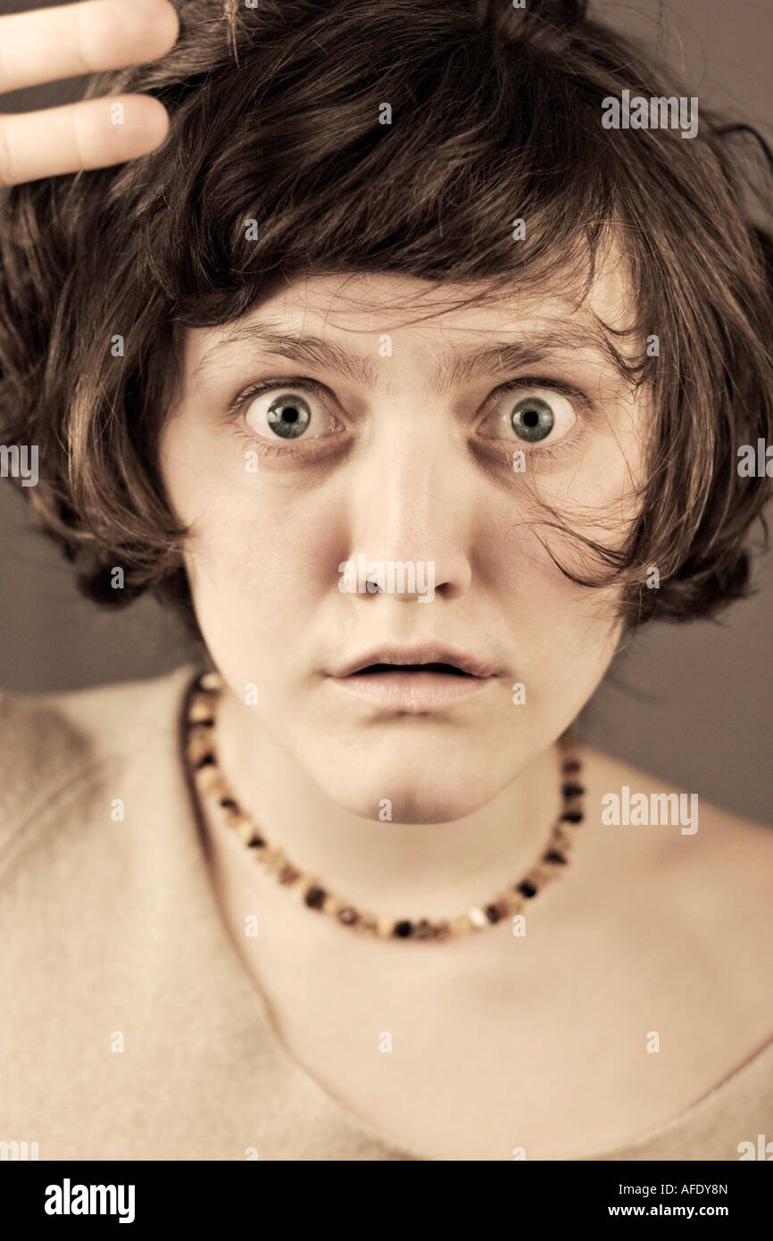 Young woman, mouth open, close-up - Stock Image