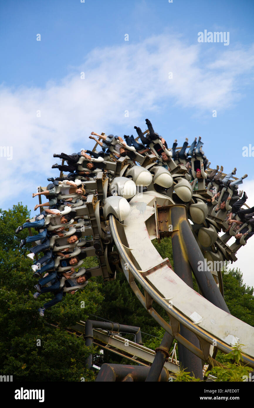 Riders inverted on Nemesis ride Alton Towers UK Stock Photo