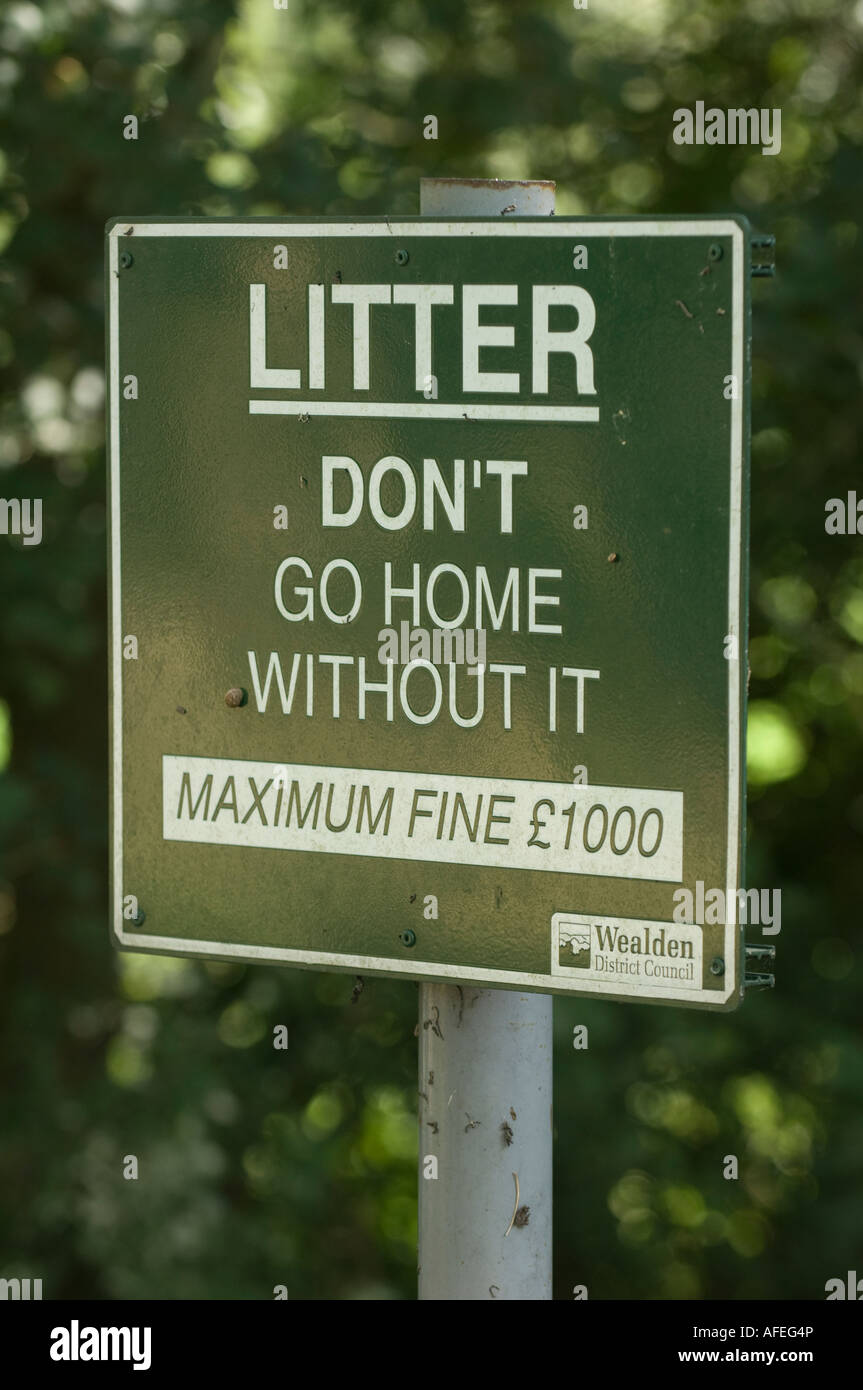 Fly-tipping: a council sign appeals for litter to be taken home. Picture by Jim Holden. - Stock Image