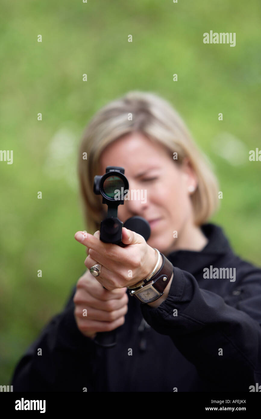 The zoo veterinary surgeon of the zoo Allwetterzoo Dr Sandra Silinski during her work with a stun gun Stock Photo