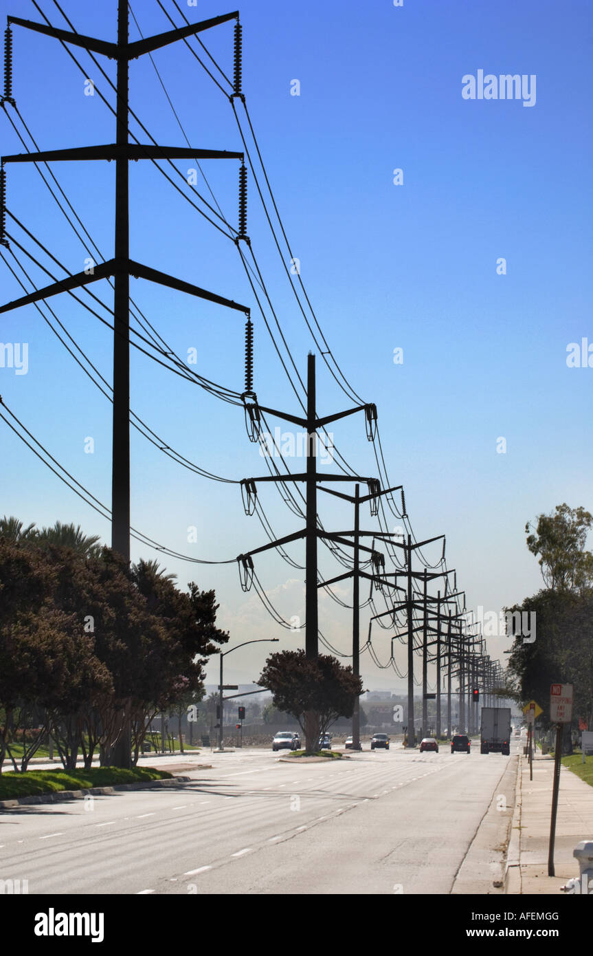 Power lines over Orange County deliver energy to residents and businesses - Stock Image