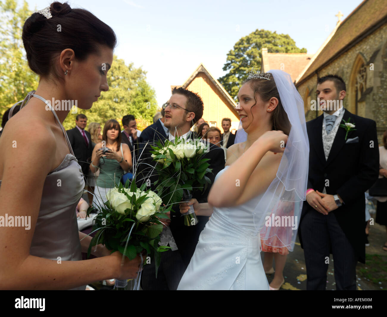 Bride Groom Best Man and Guests After Wedding - Stock Image