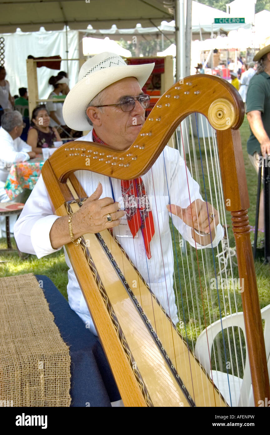 Mexican man playing the harp at the Folklife Festival in Washington D.C. July 2006 - Stock Image