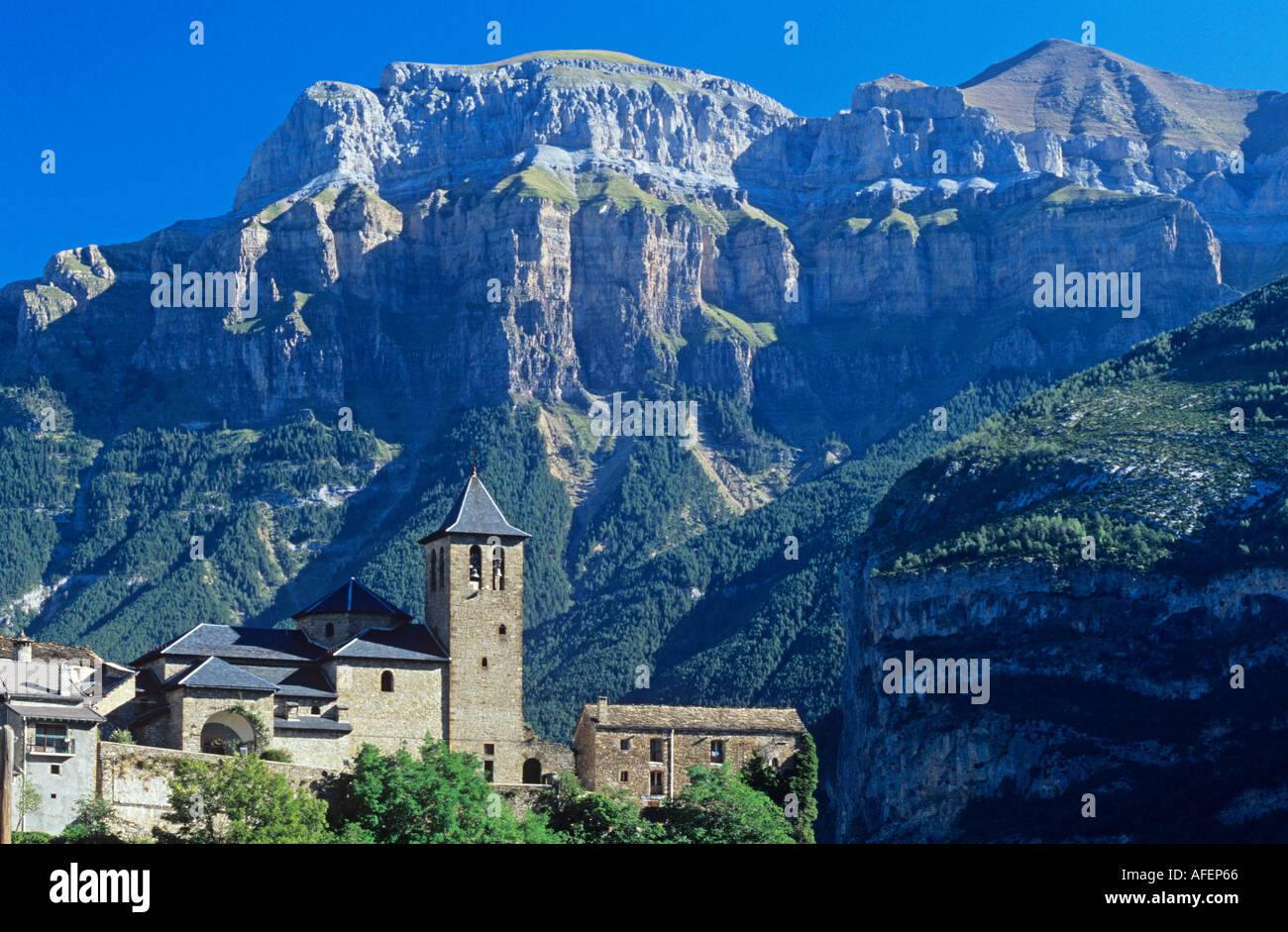 Church of Torla with Pyrenees Aragon - Stock Image