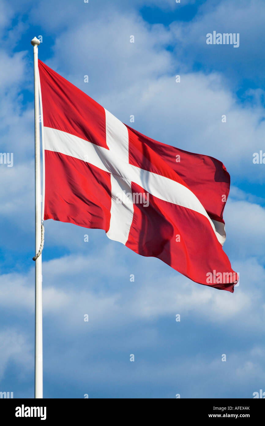 Danish Flag against a blue sky with clouds Stock Photo