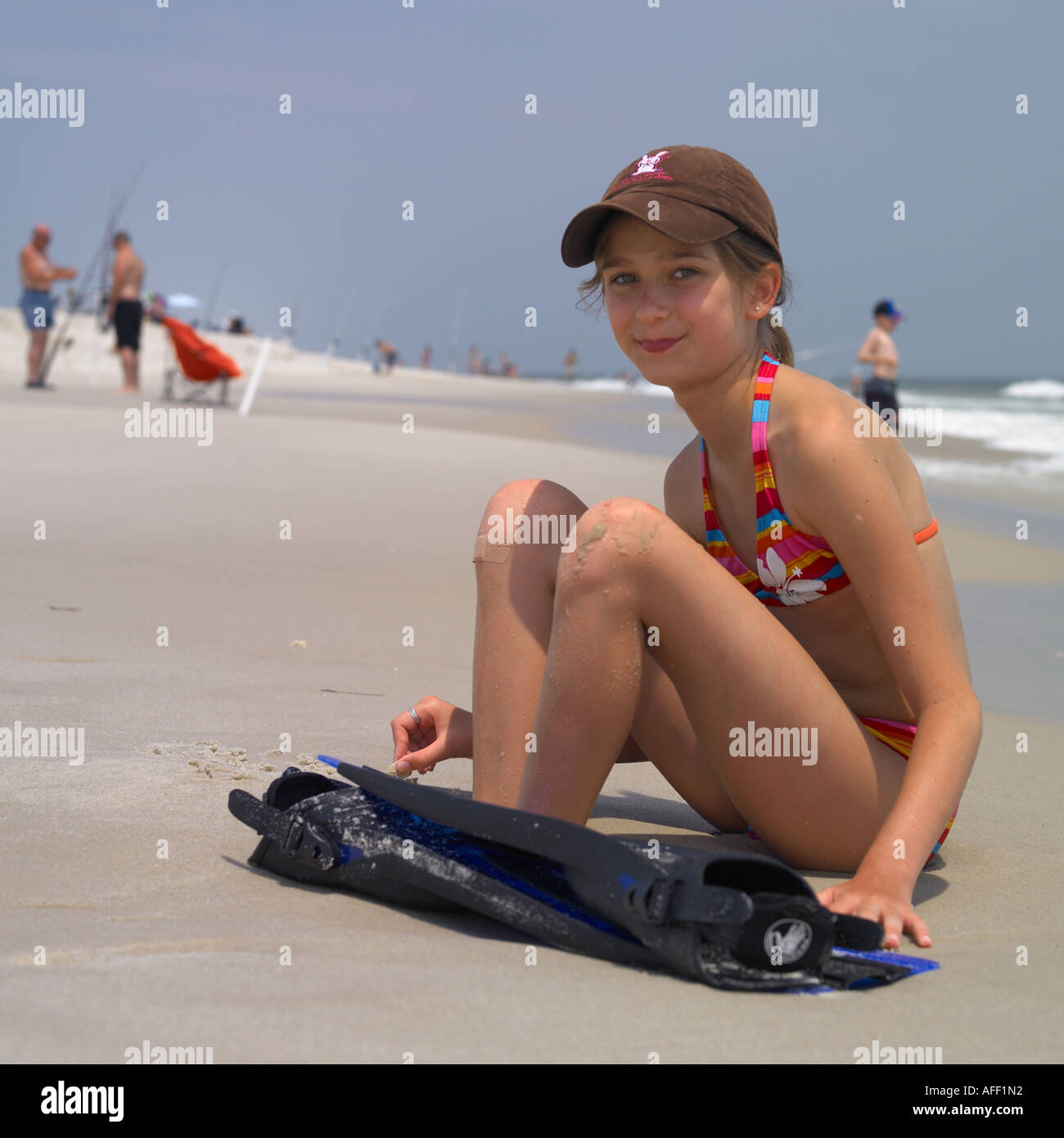portrait of a young girl with a pair of fins - Stock Image
