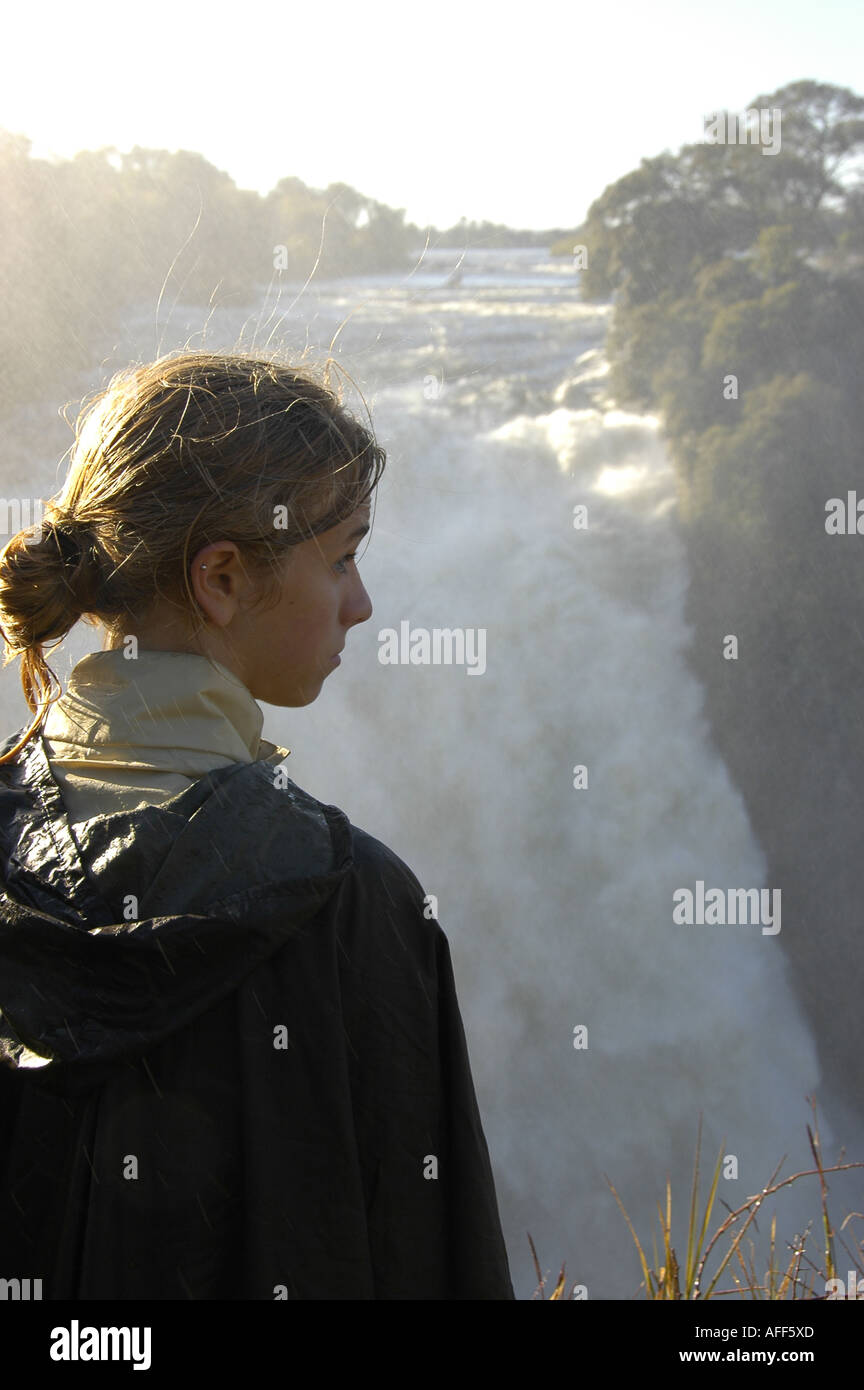 Awesome power of Devil s Cataract at Victoria Falls World Heritage Site Tourist stares mesmerized at the falls - Stock Image