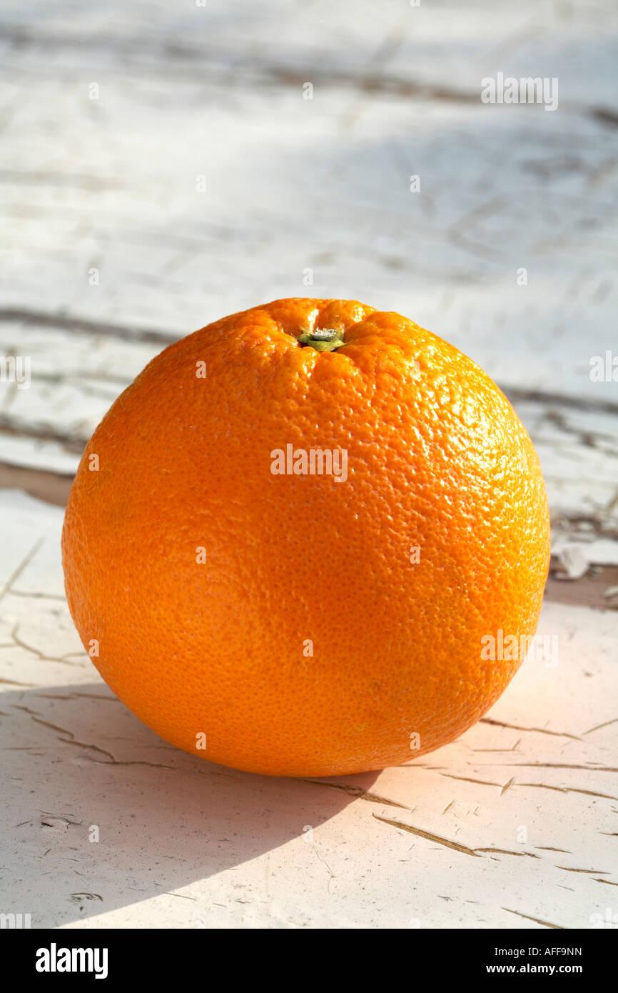Whole Orange Citrus Fruit on old painted wood background - Stock Image