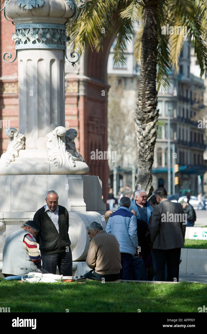 Group of men talking Passeig de Lluis Companys Barcelona Catalonia Spain - Stock Image