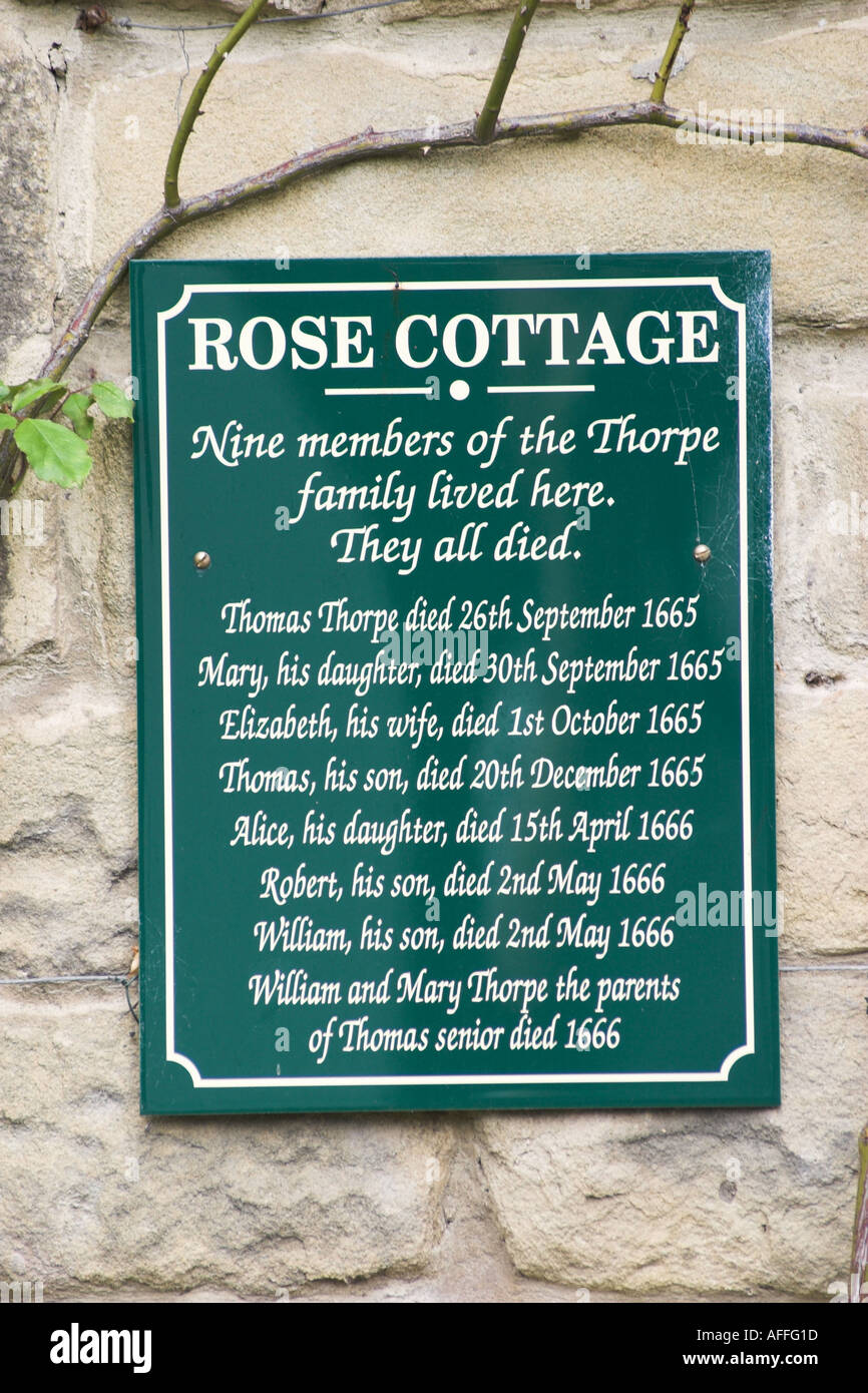 Plaque about the Thorpe family who died durring the plague in Eyam Derbyshire UK Stock Photo