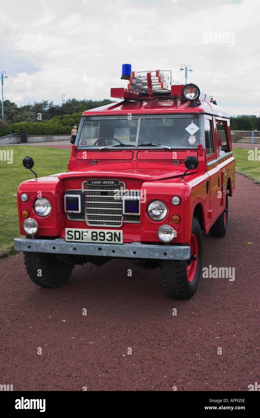 Old time fire engine on display on the sea front. Morecambe, Lancashire, United Kingdom - Stock Image