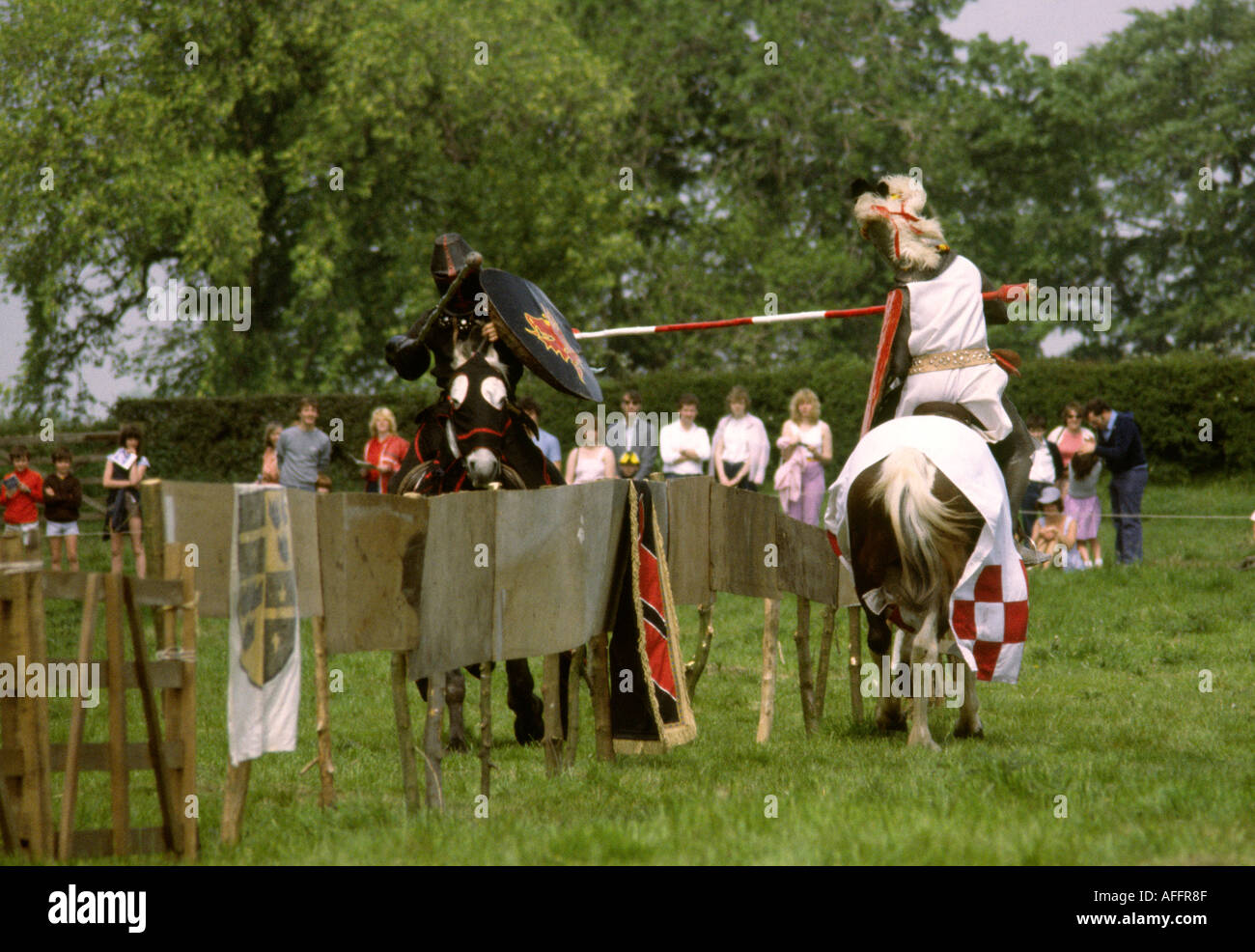 Entertainment medieval knights jousting at country fair - Stock Image