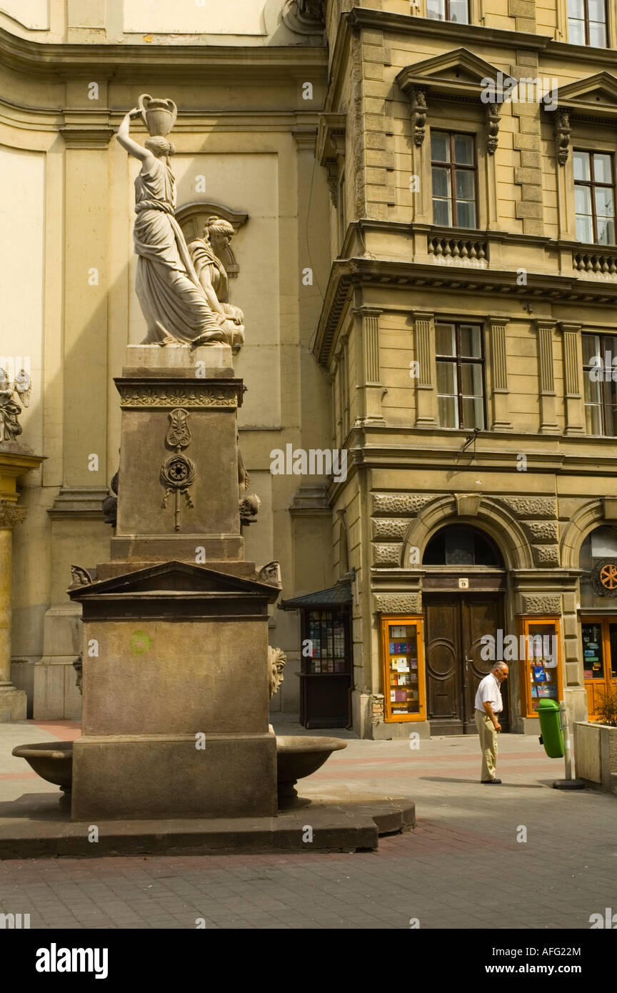 Man smoking at Ferenciek tere square in central Budapest Hungary EU Stock Photo
