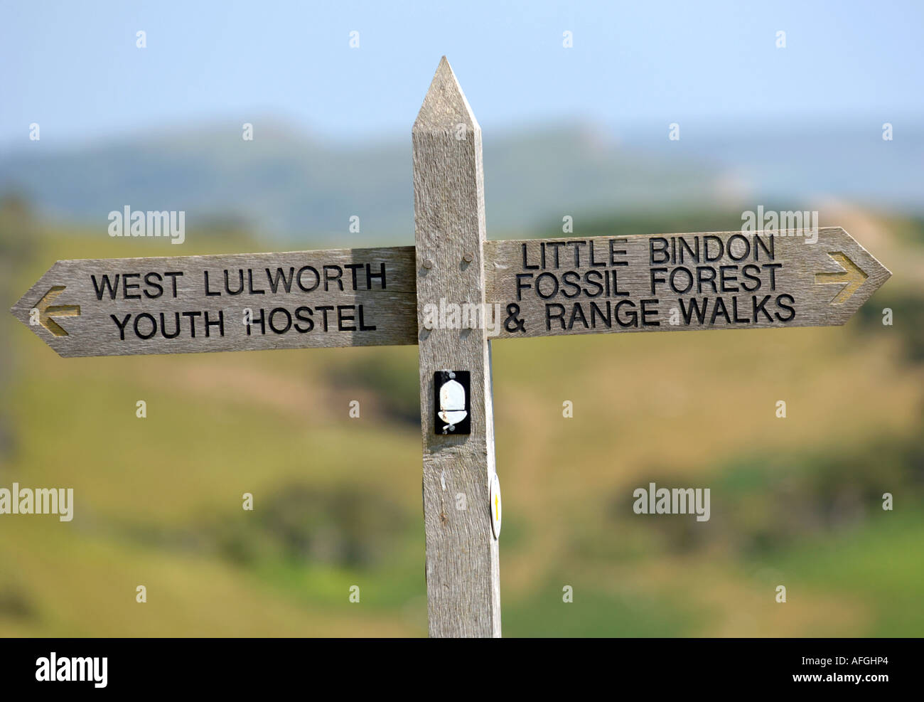 Signpost for West Lulworth Youth Hostel and forest and range walks, Dorset, Britain, UK - Stock Image