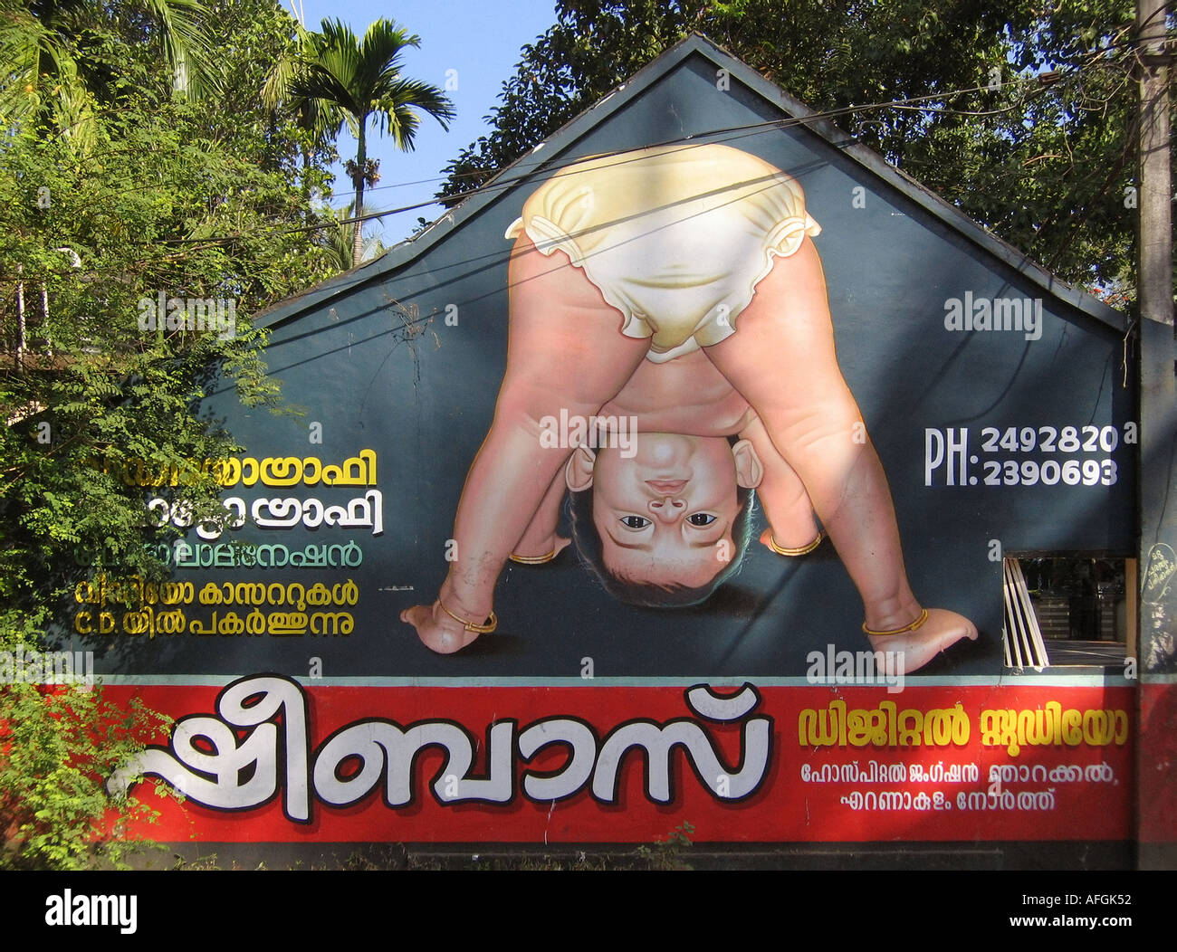 Ad showing a baby with diapers nappies on Vypeen Island near Fort Cochin in Kerala in India - Stock Image