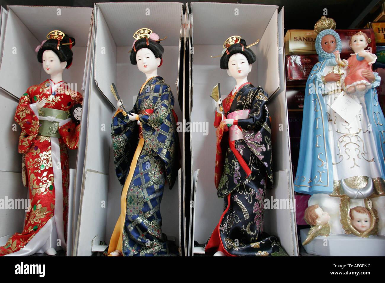 Miami Florida Little Havana Calle Ocho new age store Spanish language Chinese dolls Christian statuette - Stock Image