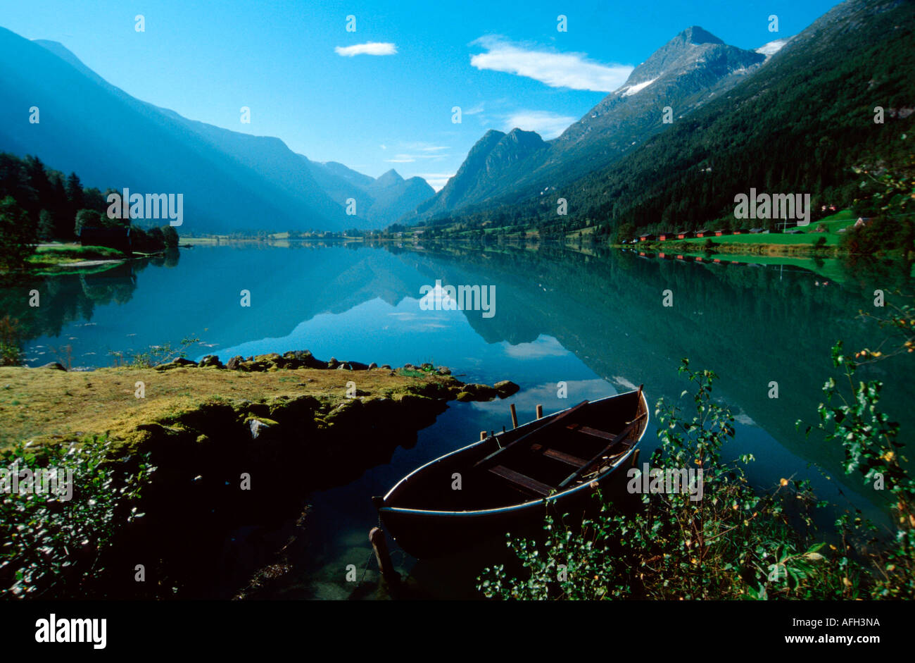 Rowing boat at shore of lake, Olden, Briksdal, Norway - Stock Image