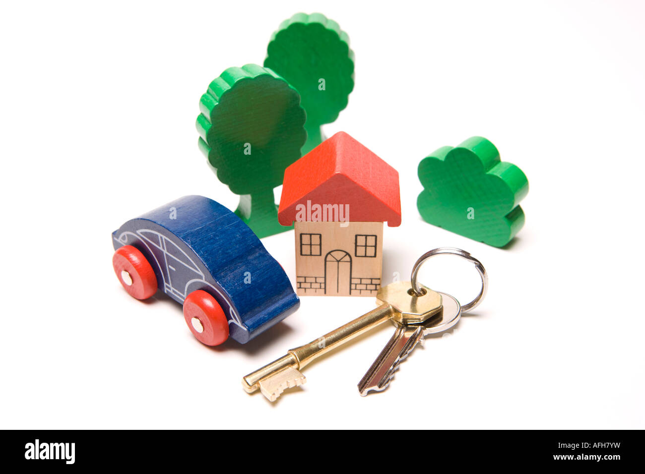 Housing key to house or property in the suburbs or the country with car outside - Stock Image