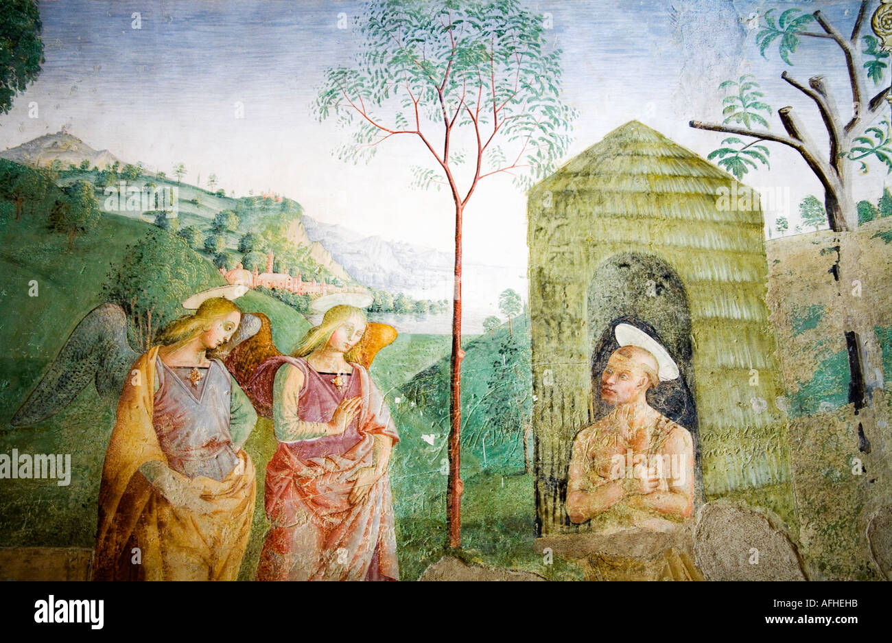 St Saint Francis of Assisi with angels fresco in the grounds of Basilica church of Santa Maria degli Angeli Assisi Umbria Italy - Stock Image
