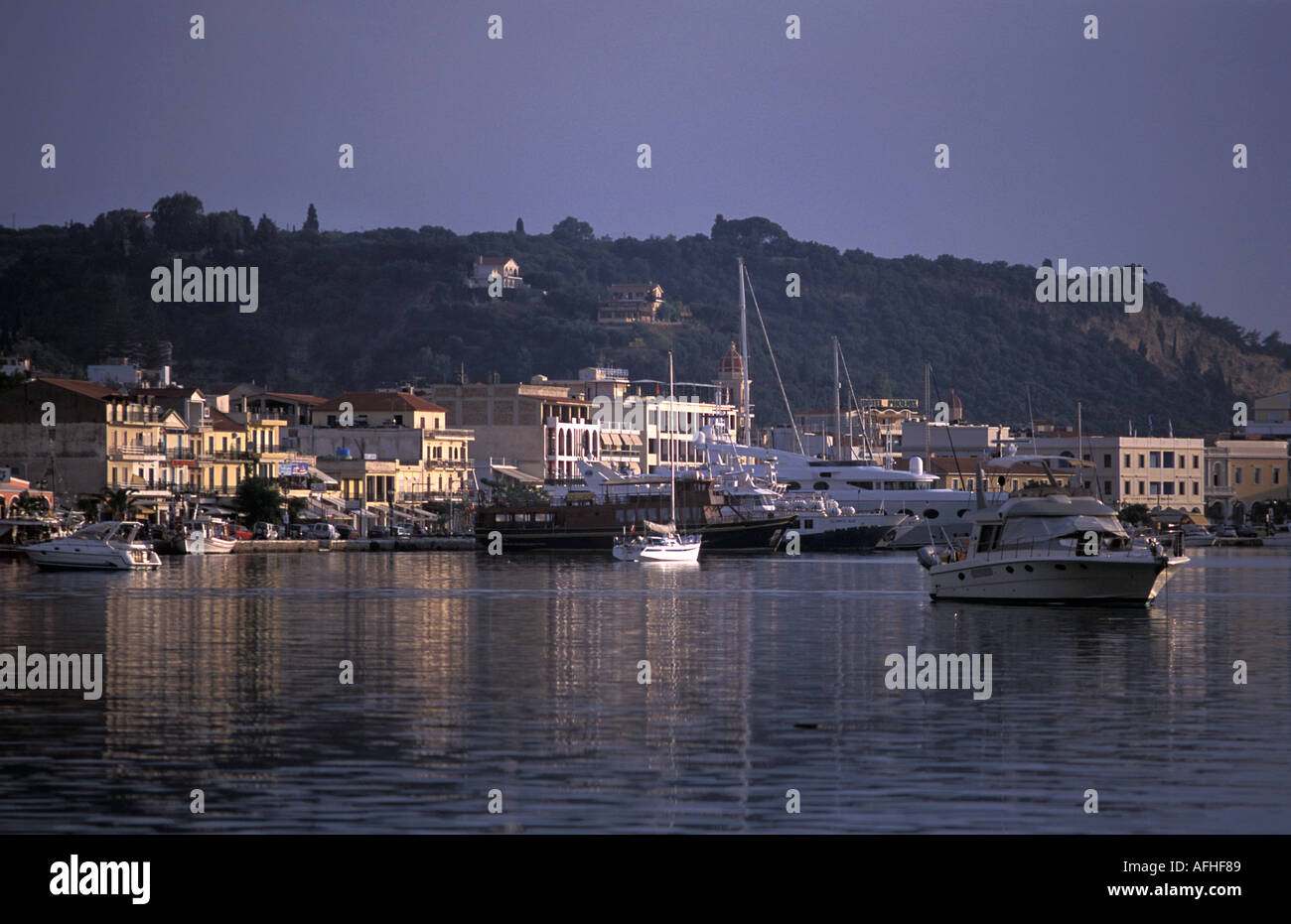 Zakynthos town and harbour viewed from boat Zakynthos island also known as Zante Ionian Islands Greece Mediterranean Sea - Stock Image