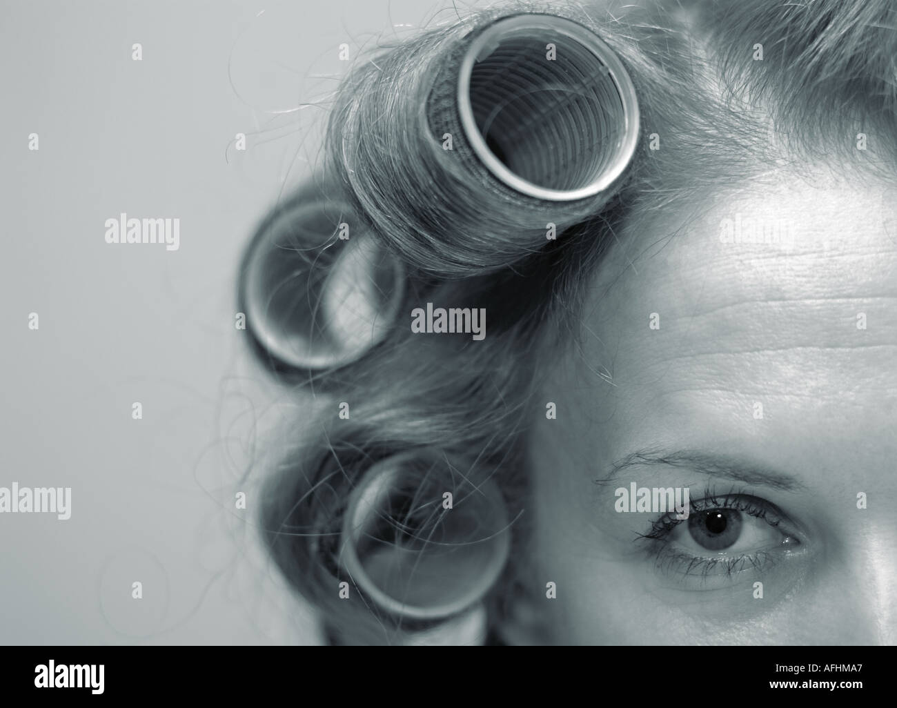 Abstract of a Young Woman with Rollers in Her Hair - Stock Image