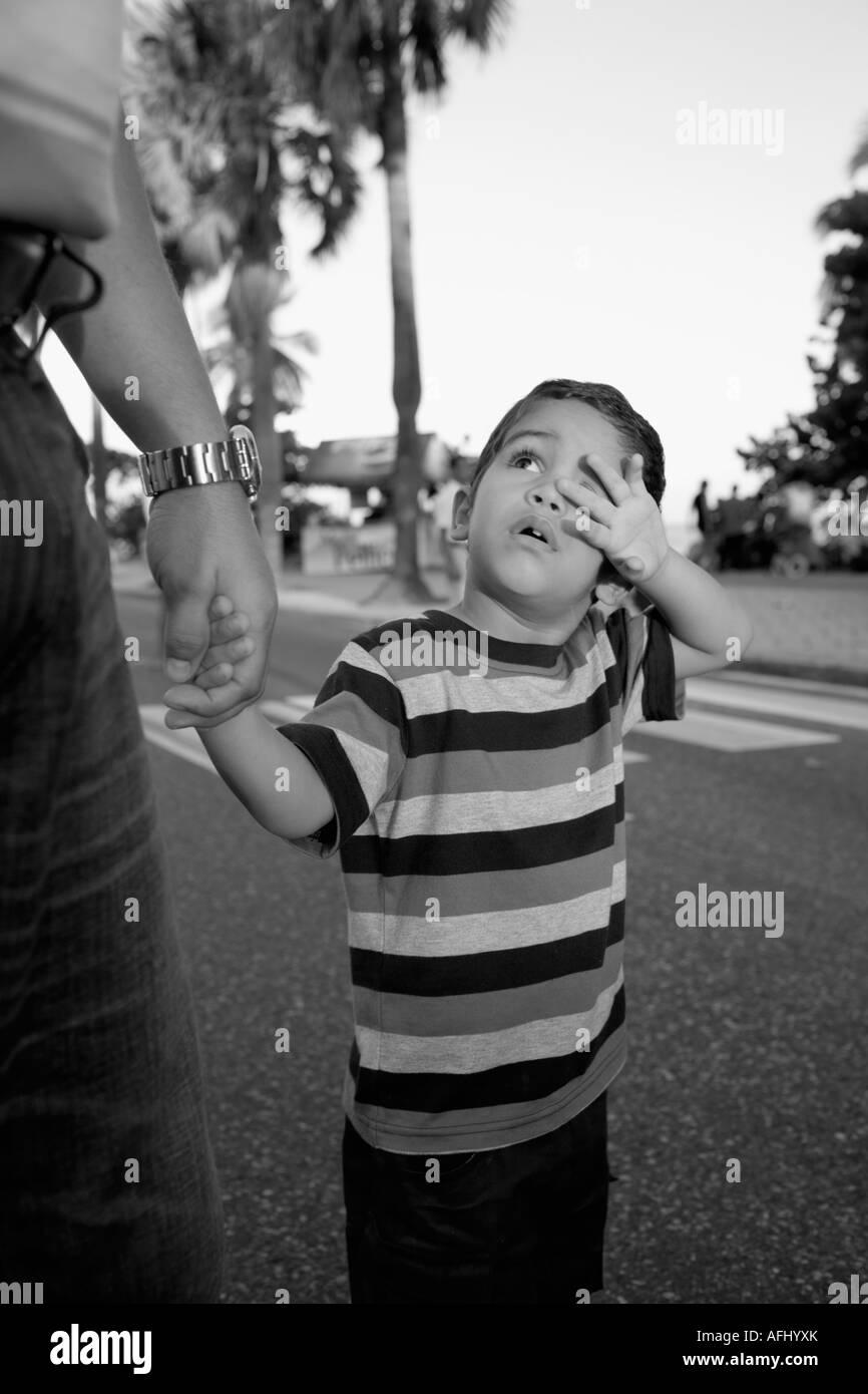 Boy holding his father's hand - Stock Image