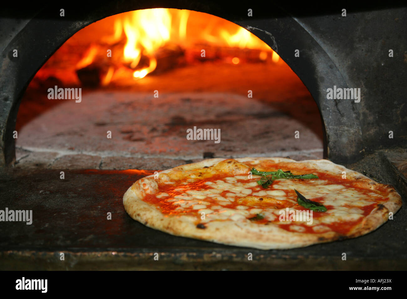 Just cooked Pizza from a real fire oven in Naples Italy Stock Photo