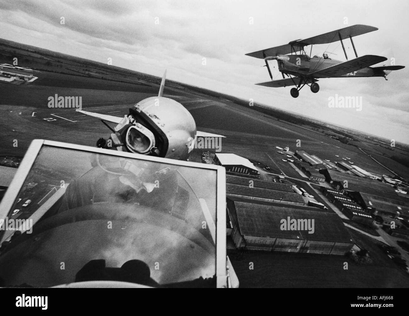 Tiger Moth aircraft fly over the former RAF Flying Training School at Sywell, UK. - Stock Image