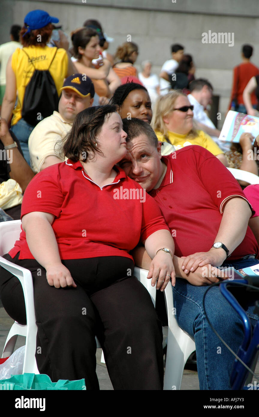 Disabled couple caught in a tender moment while watching a performance at the Liberty Festival, London - Stock Image