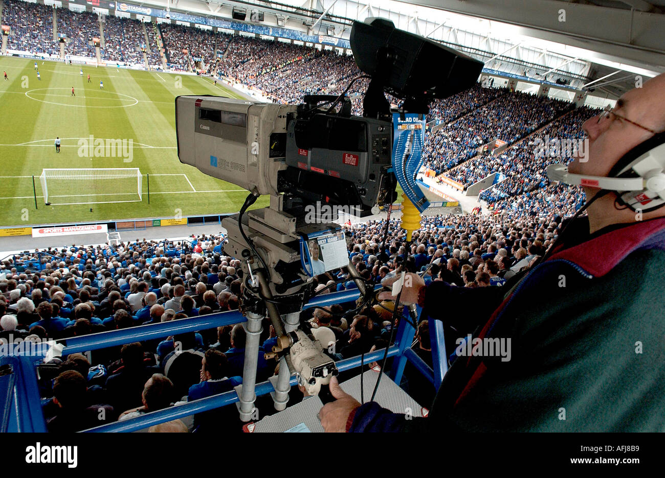 TV camera focuses on football pitch - Stock Image
