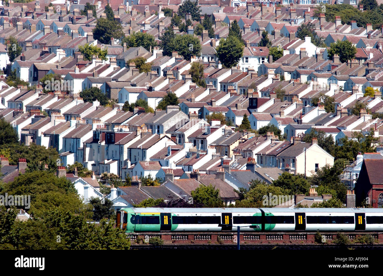 Modern commuter line uses old Victorian viaduct in Brighton to take commuter trains at rooftop level over the city. - Stock Image