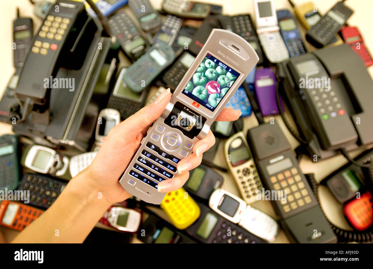 Vodafone shows off 20 years of mobile phone styles from 1984 to 2004 - Stock Image