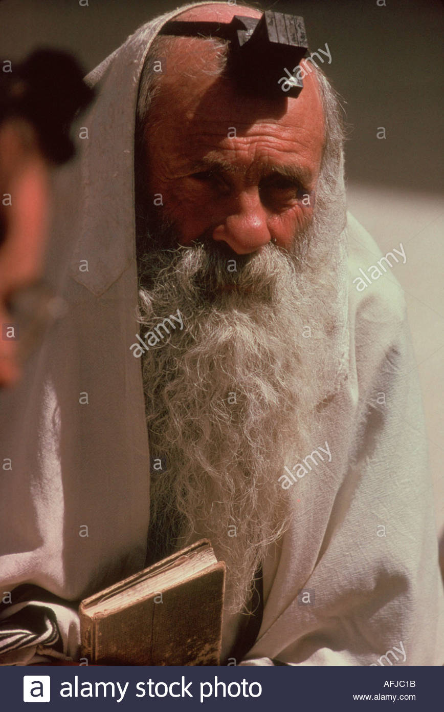 ISRAEL Old Jerusalem next to the Wailing Wall at a Bar Mitzvah a Rabbin wearing a teffilin containing holy letters of the Torah - Stock Image