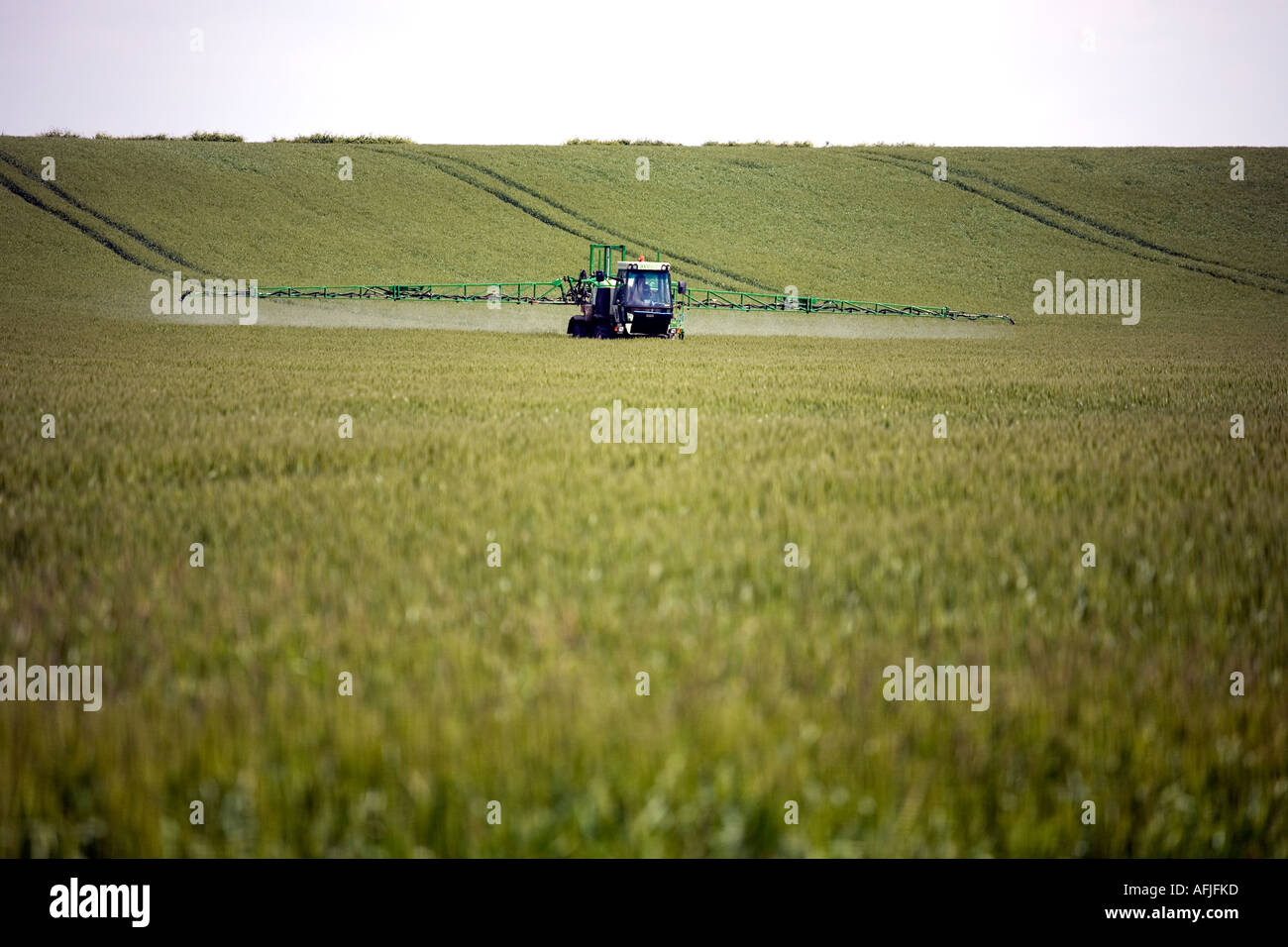 A crop sprayer in action in a field near Tewkesbury Gloucestershire England UK - Stock Image