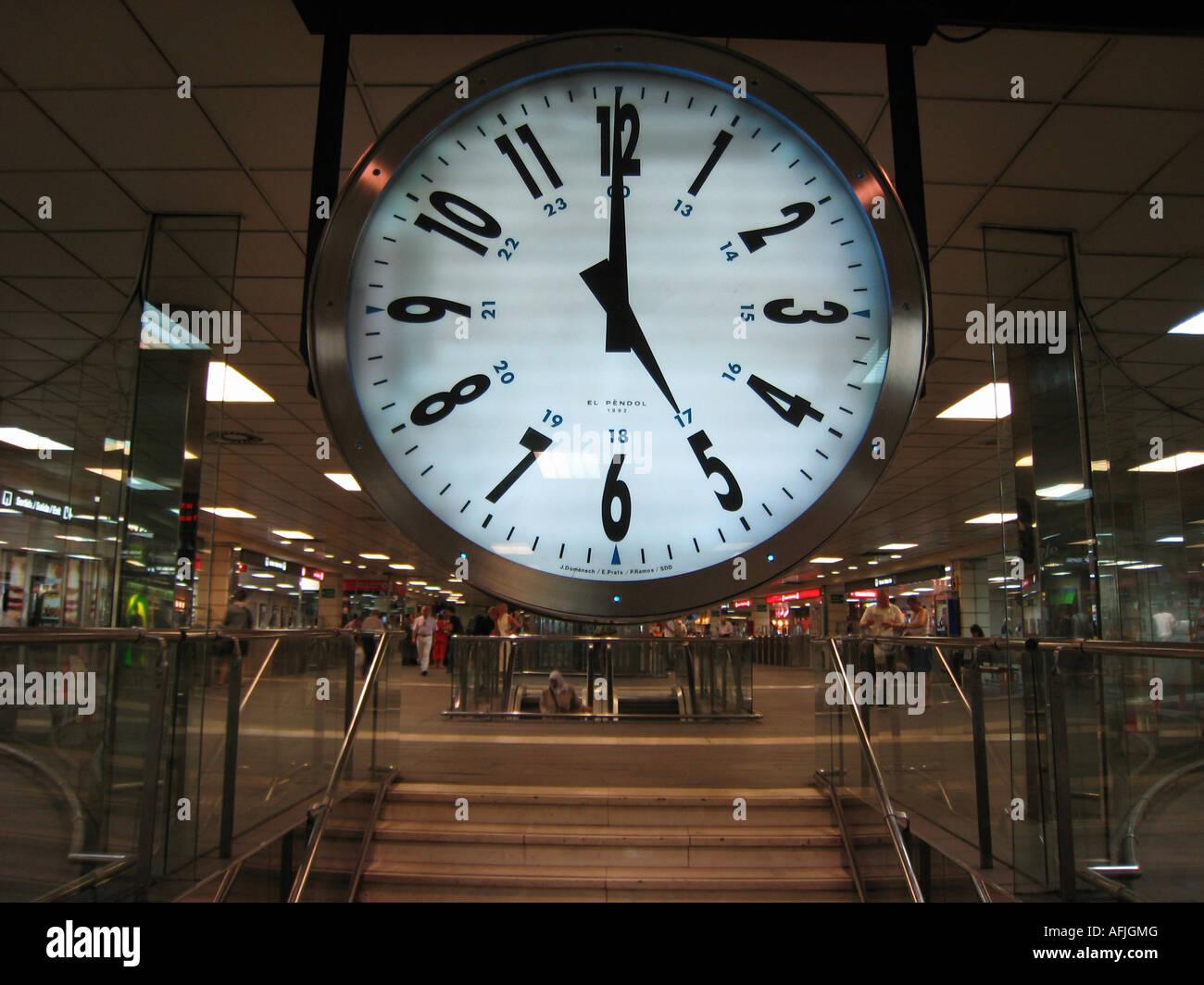 large railway clock at underground station Place de Catalunya Barcelona Spain Stock Photo