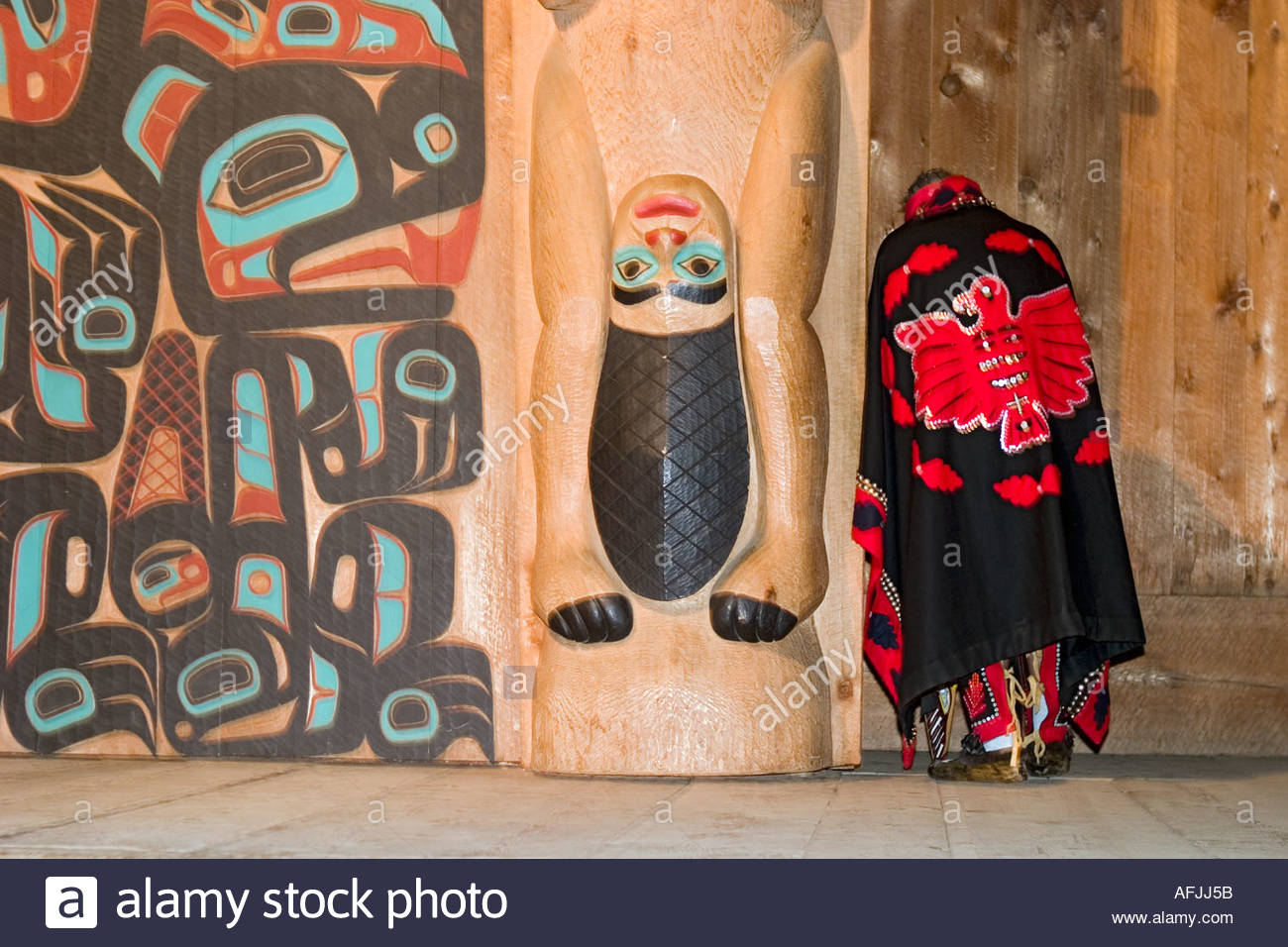 Native American Indian elder stands by totem pole in longhouse ... on indian pueblo, indian tomahawk, indian village, indian roundhouse, indian hogan, indian sweat bath, indian house, indian weapons, indian palisades, indian teepee, indian log cabin, indian igloo, indian diorama, indian baskets, indian spears, indian arrow, indian wigwam, indian buckskin, indian tipi, indian clay pots,
