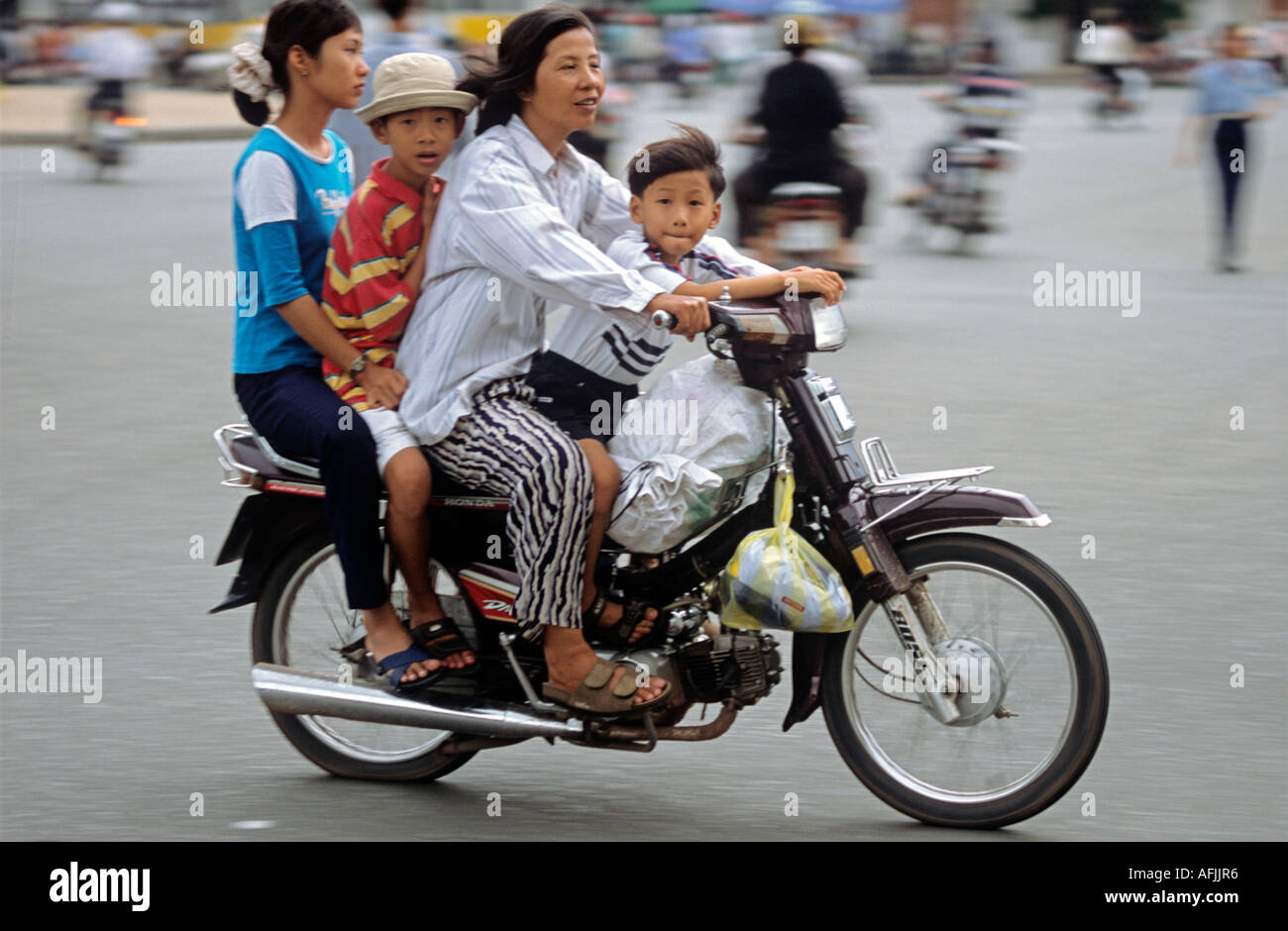 motorcycle family photo  Four Family On Scooter Motorcycle Stock Photos