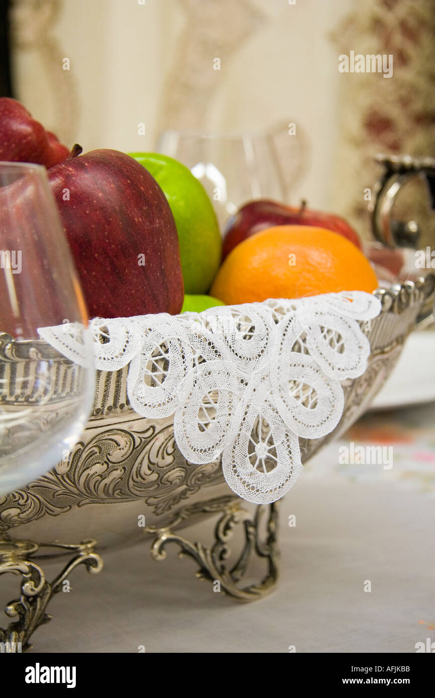 Burano lace and fruit bowl - Stock Image