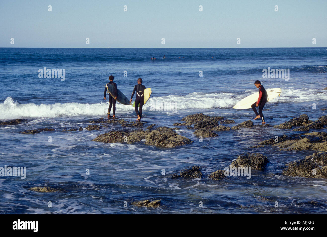 A new generation of black surfers hit Jeffreys Bay in South Africa - Stock Image