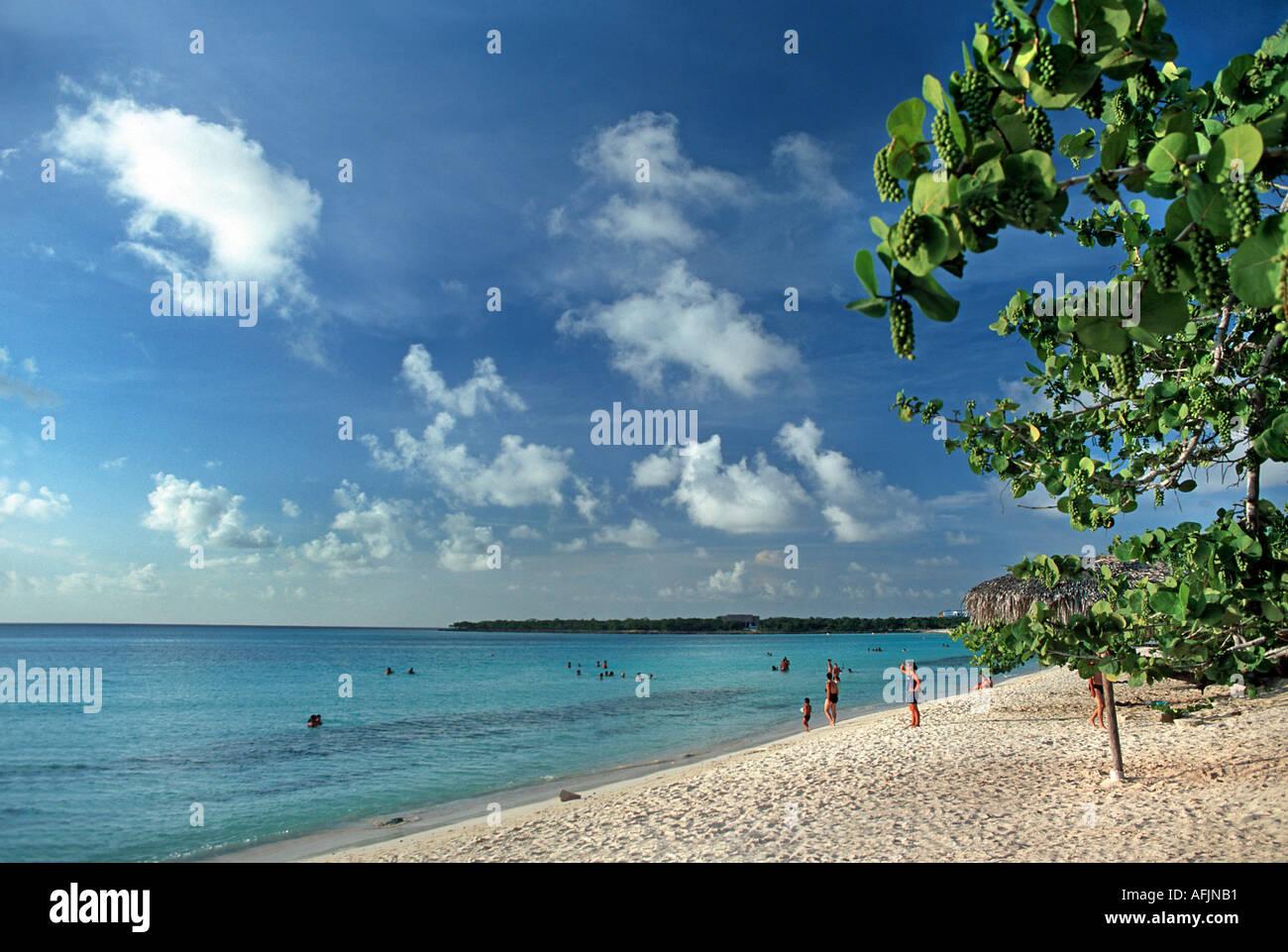 Holidaymakers on the beach at Playa Pesquero Guardalavaca Holguin Cuba - Stock Image