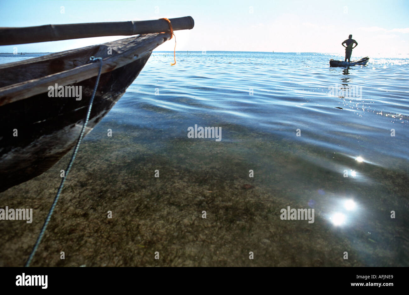Fisherman sets out in his dug out canoe Straits between Mafia island and Chole island South of Zanzibar Tanzania Stock Photo