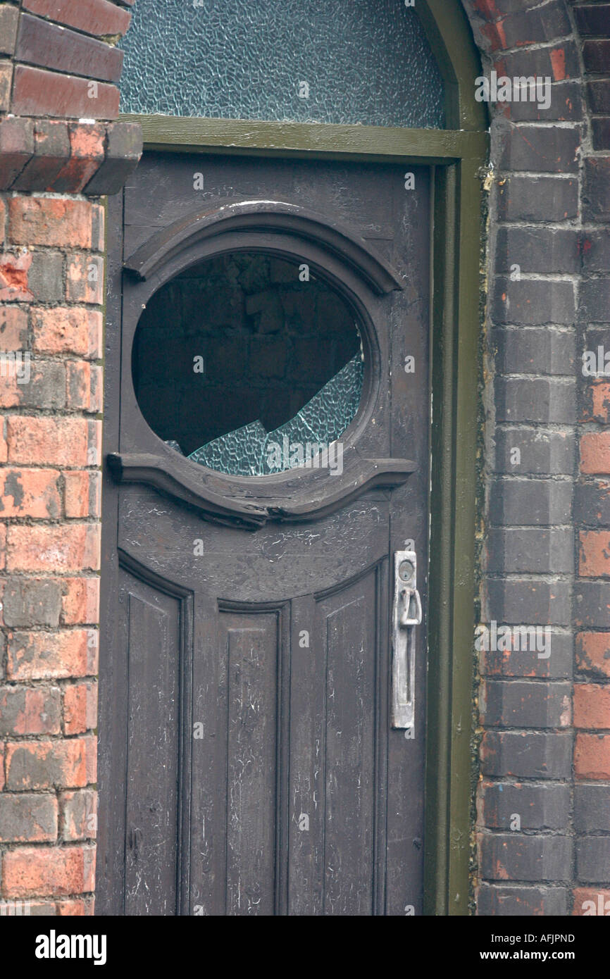 Remains Of Bombed Out Brown Old Front Door With Smashed Window In