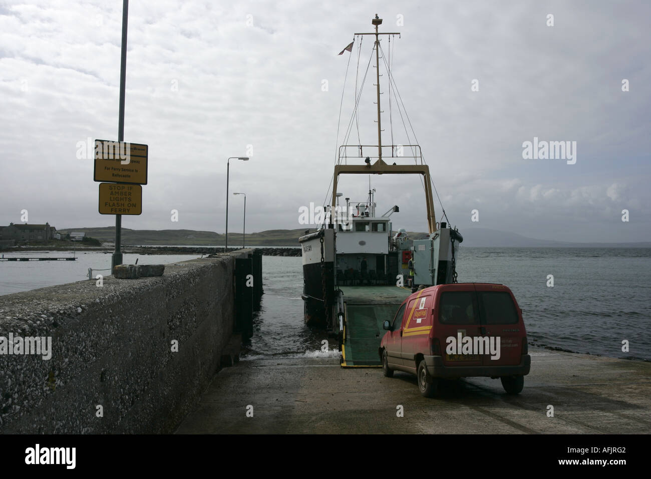 bow vehicle loading ramp of the Caledonian MacBrayne MV Raasay  ferry down loading a post office van - Stock Image