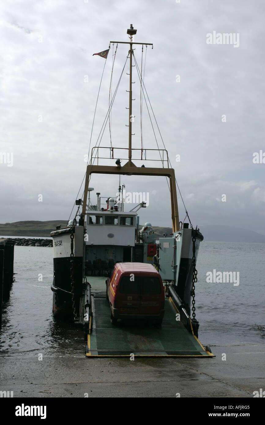 bow vehicle loading ramp of the Caledonian MacBrayne MV Raasay  ferry down loading a post office van in Rathlin Island - Stock Image