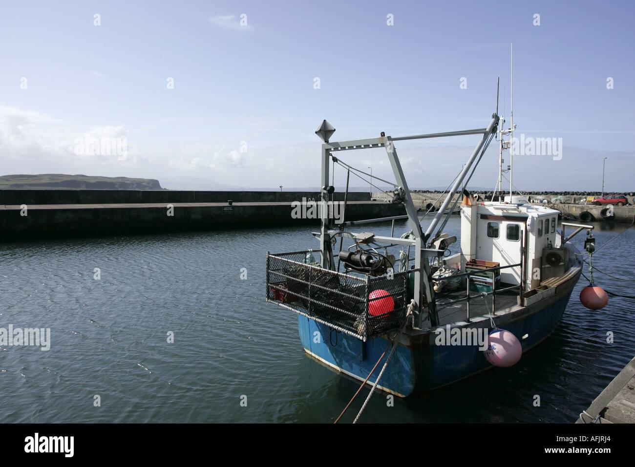 fishing boat tied up in rathlin harbour Rathlin Island northern ireland - Stock Image