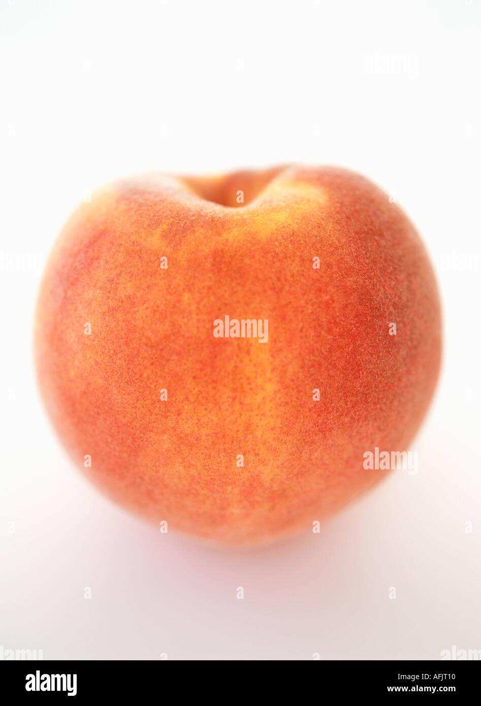 Peach on white background - Stock Image