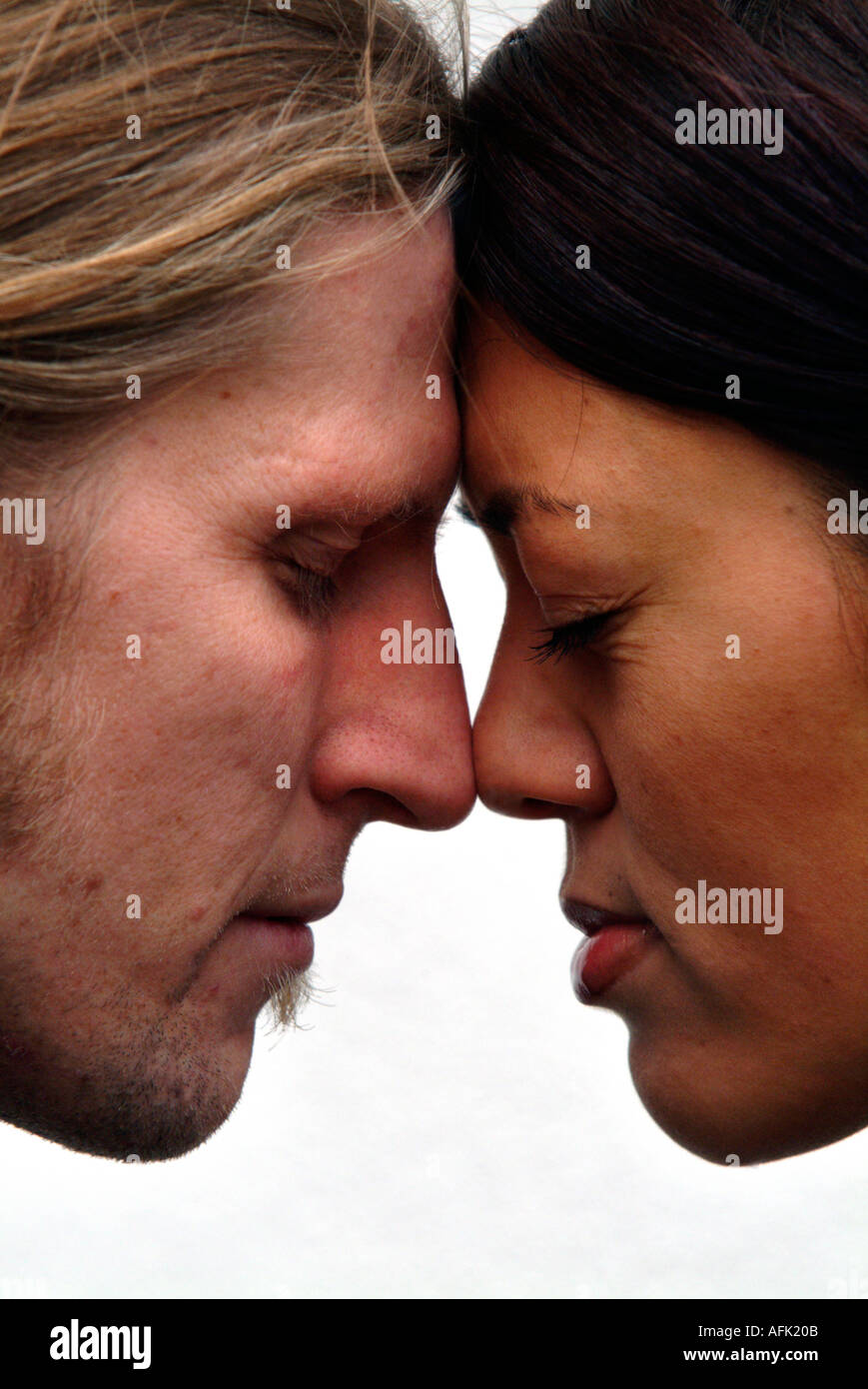 Maori Greeting Hongi: Hongi Maori Greeting Male And Female In Profile Stock