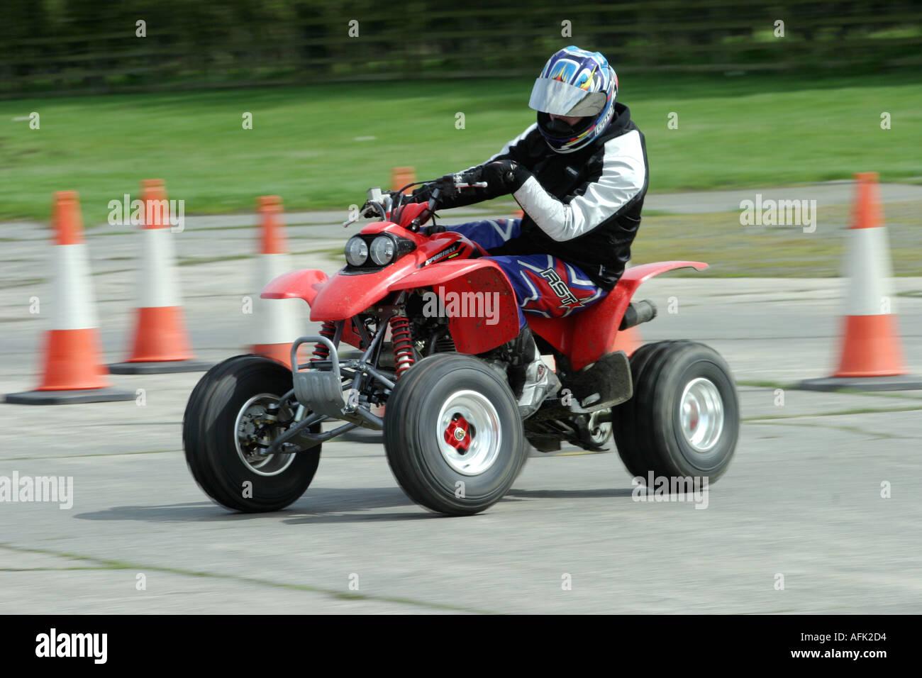 Stuntman on a quadbike - Stock Image